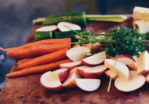 Healthy natural ingredients like carrots, and apples on a table