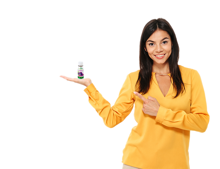 Woman holding bottle of healthyshot grape cherry flavored beverage