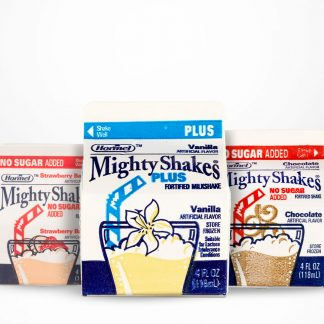 Mighty Shake flavors on table with white background