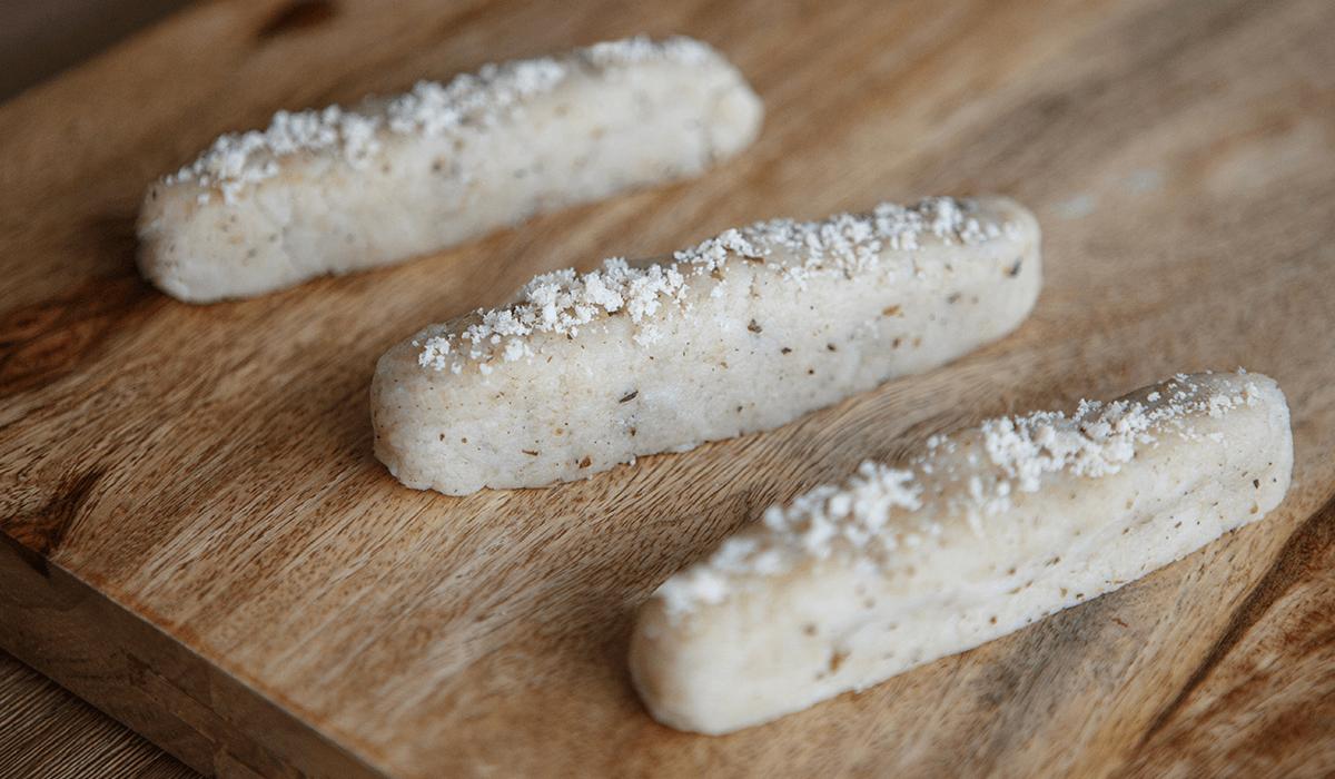 Level 4 herb pamesan breadsticks served on a butcher's block