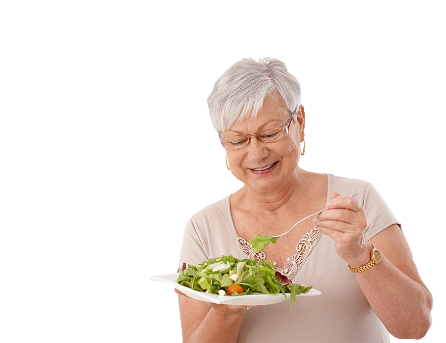 Older Woman eating a salad and smiling