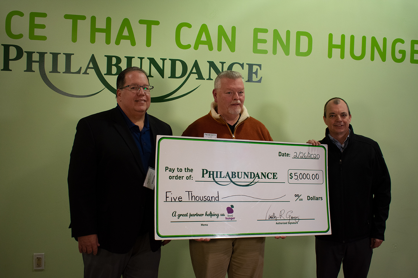 Hormel Health Labs donating check to Philabundance