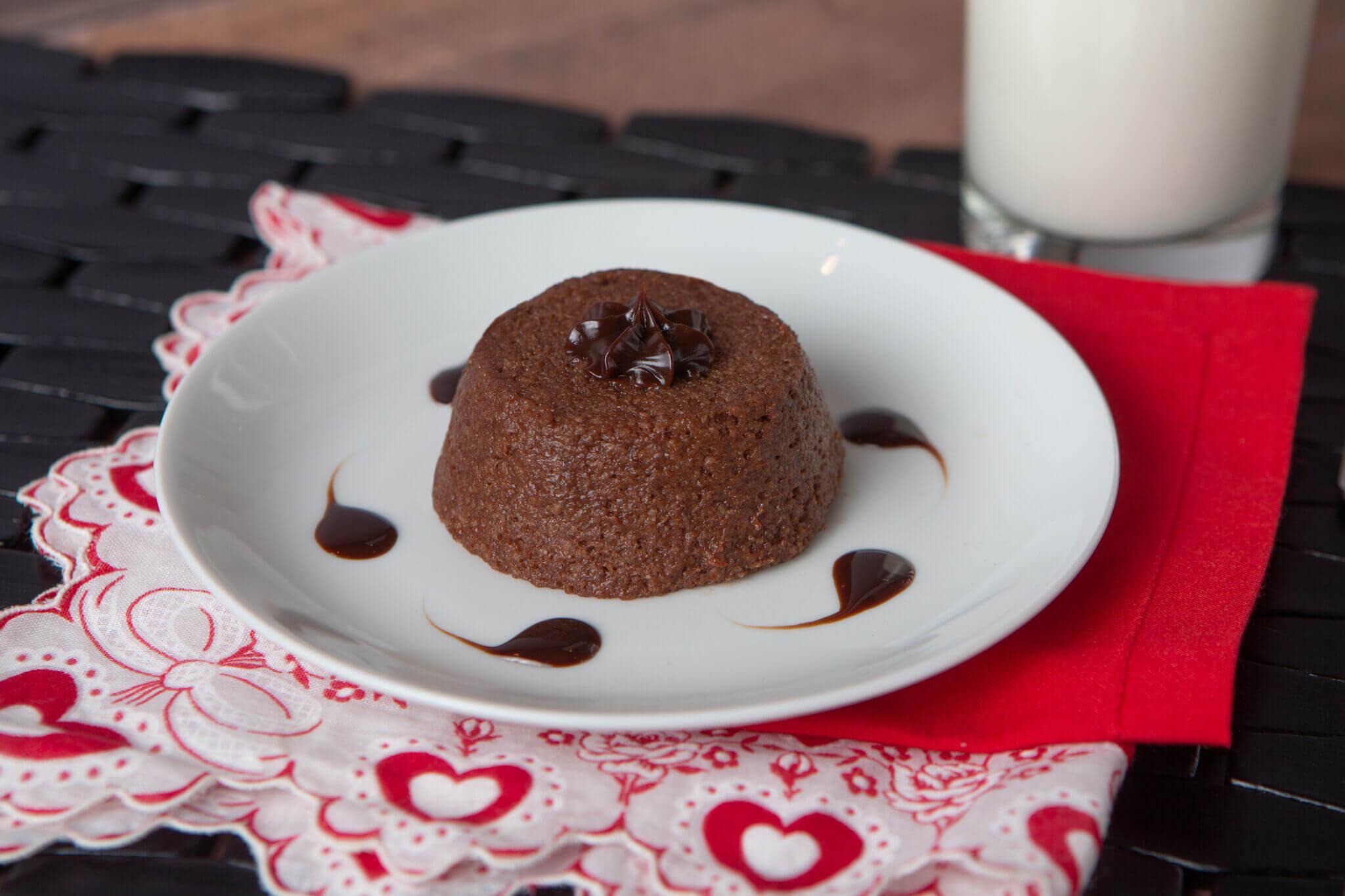 A pureed chocolate lava cake on a plate
