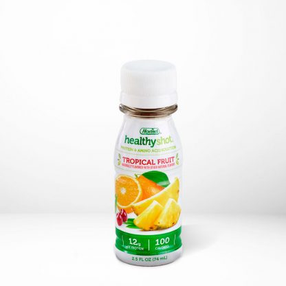 HealthyShot Tropical Fruit flavor on table with white background
