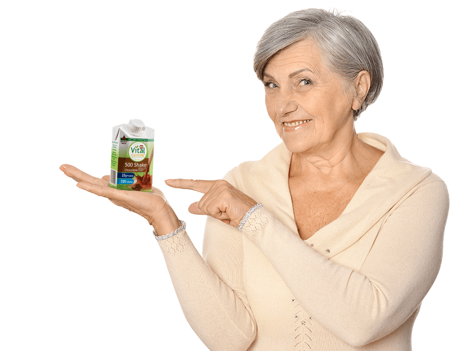 woman holding Vital Cuisine 500 shake chocolate flavor